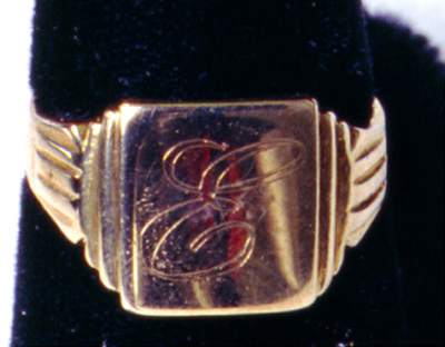 "1953 Elvis Presley's ""E"" Humes High School Ring. A 10kt. gold initial ring from Humes High School in Memphis, TN with the initial ""E"" inscribed on the top of the ring."