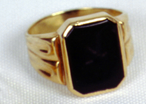 "1956 Elvis Presley's Louisiana Hayride Ring. 18K gold black onyx ring inscribed with ""LH-55"""