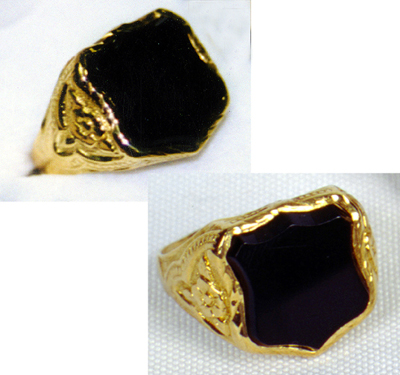 1957 Elvis Presley's Memphis Police Shield Ring. A simple black onyx ring made into the shape of a policeman's shield.